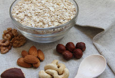 Particularly gentle oatmeal with nuts. On natural fabric Royalty Free Stock Images