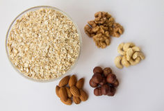 Particularly gentle oatmeal with nuts. On a white background Royalty Free Stock Photography