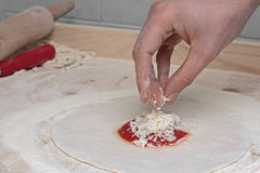 Particularly the preparation of pizza Stock Image