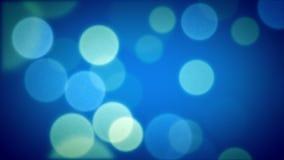 Particules molles de lumière de foyer bleues banque de vidéos