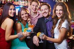 Partido con los amigos Foto de archivo libre de regalías