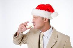 Partido corporativo Un hombre atractivo está bebiendo el champán imágenes de archivo libres de regalías
