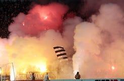 Partido de fútbol entre Paok y Olympiacos Imagen de archivo libre de regalías