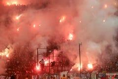 Partido de fútbol entre Paok y Olympiacos Imágenes de archivo libres de regalías