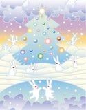 Partido de la liebre bajo el árbol de navidad Imagen de archivo libre de regalías