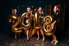 Partido del Año Nuevo con las muchachas hermosas Imagen de archivo