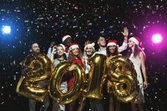 Partido del Año Nuevo de la oficina Gente joven que se divierte Fotografía de archivo