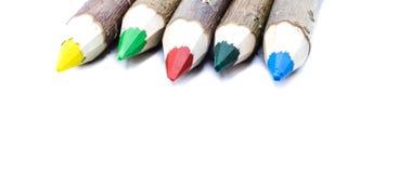 Partidos simbólicos de los colores de los lápices coloridos fotografía de archivo libre de regalías