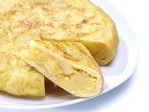 Partie d'omelette espagnole. Omelette de pommes de terre. Image stock