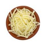 Partie de fromage de cheddar doux blanc naturel dans la cuvette photos stock