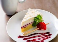 Partie de gâteau au fromage Images stock