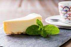 Partie de gâteau au fromage Photos stock