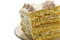 Partie de gâteau flacky doux avec de la crème, d'isolement Photo libre de droits