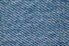 Partie de structure bleue de tissu de denim Image stock