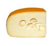Partie du fromage avec le trou isolé sur le blanc Photos libres de droits