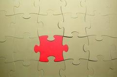 Partie rouge d'un puzzle Photo stock