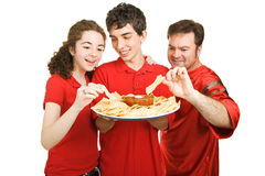 Partiers Snacking Stock Image