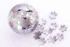Parties de puzzle de globe Photographie stock libre de droits