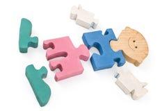 Parties en bois colorées de puzzle de garçon Photographie stock libre de droits