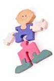 Parties en bois colorées de puzzle de garçon Photo stock