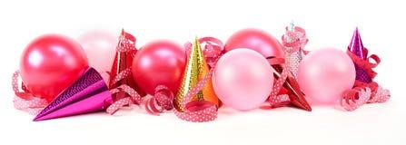 Partihattar med band och ballonger Arkivfoton