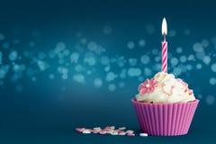 Partij cupcake met kaars Stock Foto's