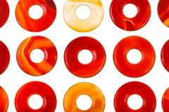 Partij van de opgepoetste cirkels van de het agaathalfedelsteen van de doughnutvorm Stock Foto's
