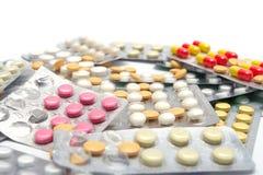 Partij van pillen bij de pakketten Royalty-vrije Stock Afbeeldingen