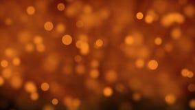 Partikel Gold-, dasbokeh Preise funkeln, wischen abstrakte Hintergrundschleife ab stock footage