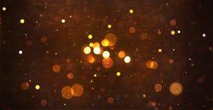 Partikel och bokeh för guld abstrakt för bakgrund Arkivbilder