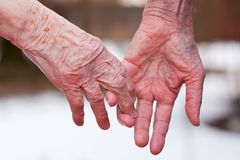 Parting. Hands of an elderly couple, close-up Stock Photography