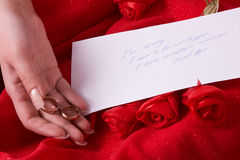 Parting note. Sad woman holding gold wedding ring. Royalty Free Stock Photo