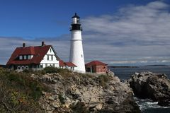 Parting storm clouds over Portland Head Lighthouse stock photos