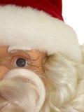 Partisk sikt av en Santa Claus dockaframsida med exponeringsglas Royaltyfri Fotografi