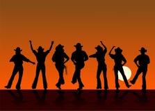 Partito del cowboy sul tramonto Immagine Stock