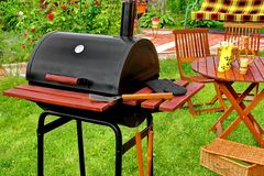 Partito della griglia del BBQ di fine settimana o concetto all'aperto di picnic Fotografia Stock