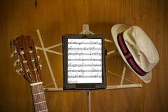 Partitura en la tableta en soporte de música Fotografía de archivo libre de regalías