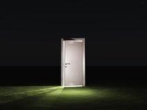 Partly closed door. Emits light Stock Photo