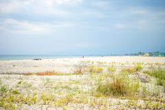 Partly cloudy day on the sandy beach in Paralia Katerini, Aegean sea, Greece Royalty Free Stock Image