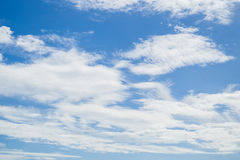 Partly cloudy in the morning sun. Stock Image