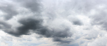 Partly cloudy sky with rain storm. Panoramic composition in high Royalty Free Stock Image