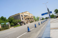 Partly coned-off asphalt road before building in sunny summer. Partly coned-off asphalt road before modern building in sunny summer,Chengdu,China stock photography