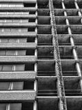 Partly demolished old concrete high rise tower block building. With construction lift Royalty Free Stock Photography