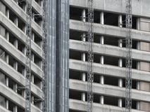 Partly demolished old concrete high rise tower block building. With scaffolding Royalty Free Stock Images