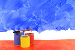 Partly painted blue wall Stock Photography