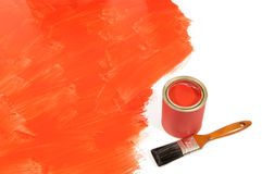Unfinished partly painted red floor, paint can, paintbrush, copy space Royalty Free Stock Photos