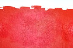 Partly painted wall in red colors Stock Photography