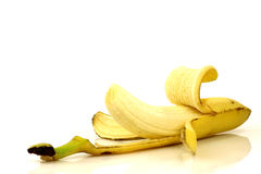 Partly peeled banana Stock Photo