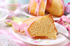 Partly sliced easter ring cake with pink icing Stock Photo