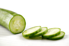 Partly sliced organic cucumber Royalty Free Stock Photography